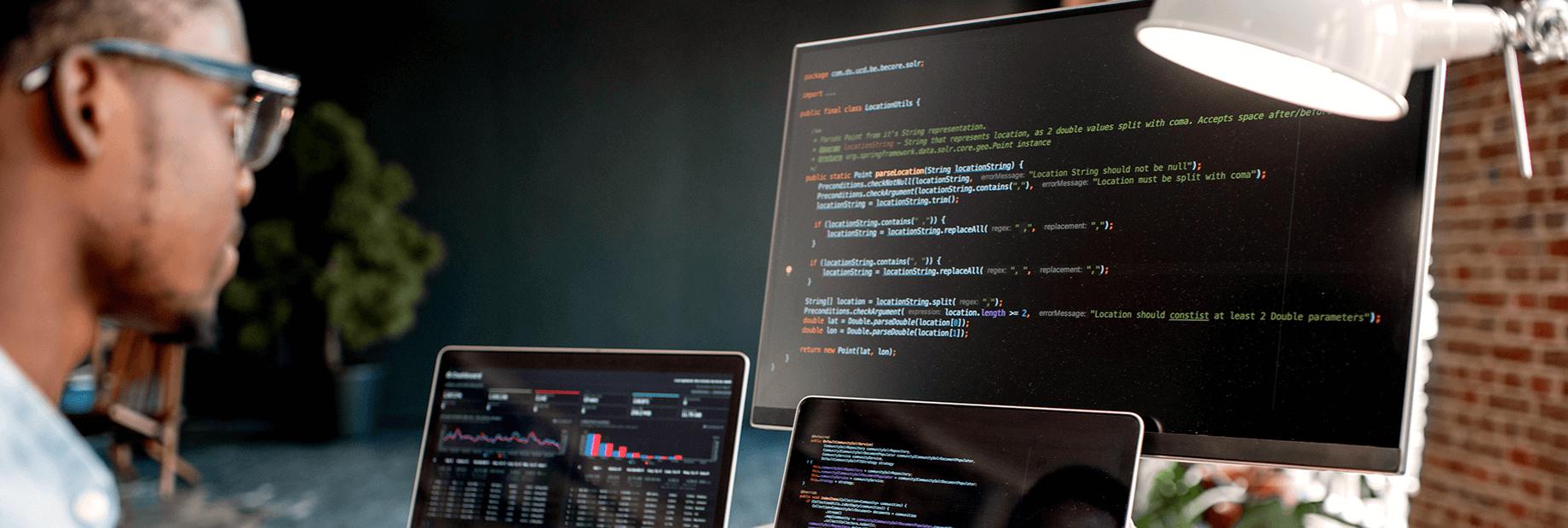 Web development employee working on computer
