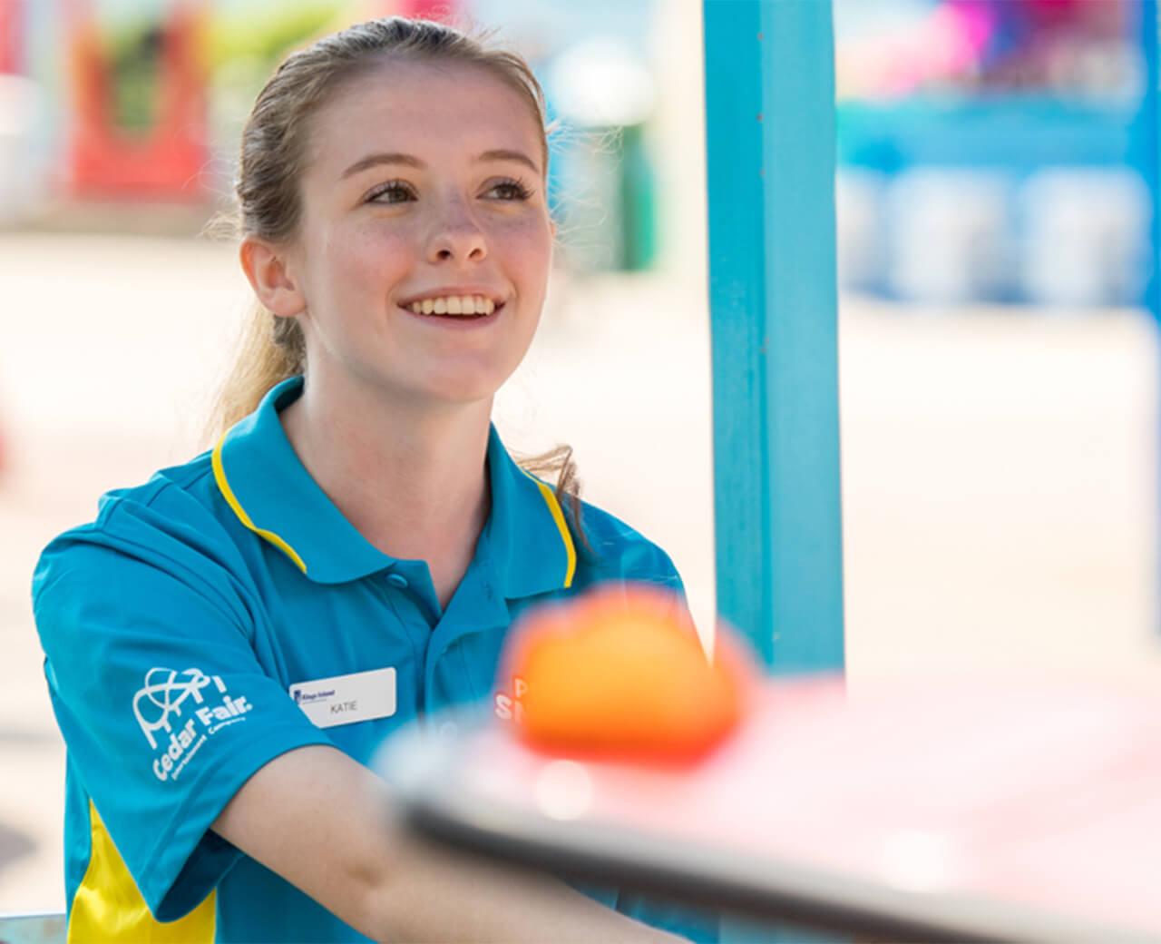 Cedar Fair employee smiling in their amusement park