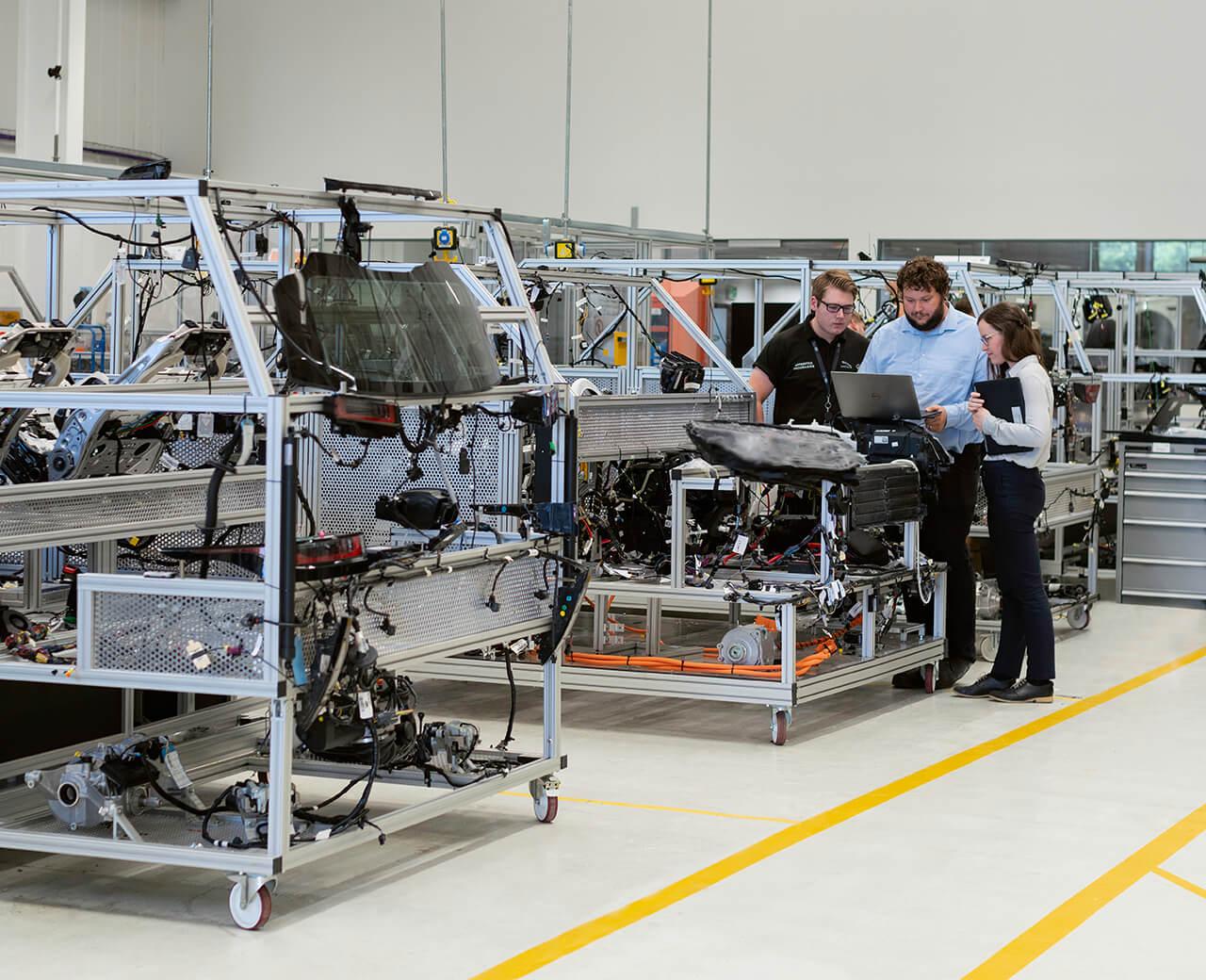 3 TT Electronics employees in a factory