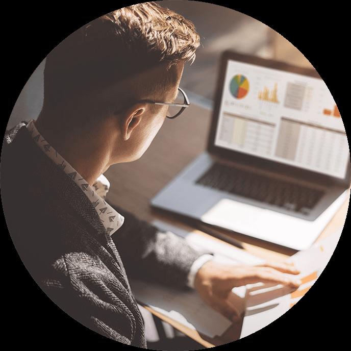 Employee analyzing data on his laptop computer