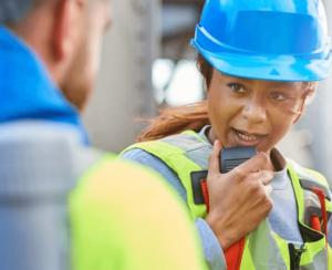 Celanese manufacturing plant employee on walkie talkie